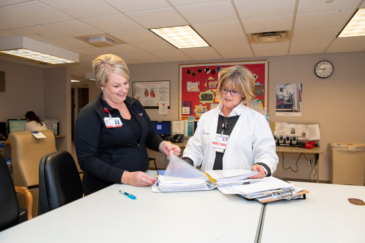 Kelly Besl and Ann Florian, working as case managers at UC Medical Center