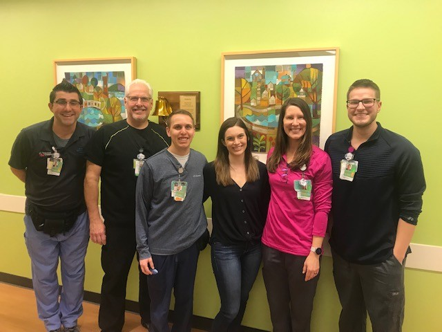 Meagan Barrick with her care team at the Proton Therapy Center