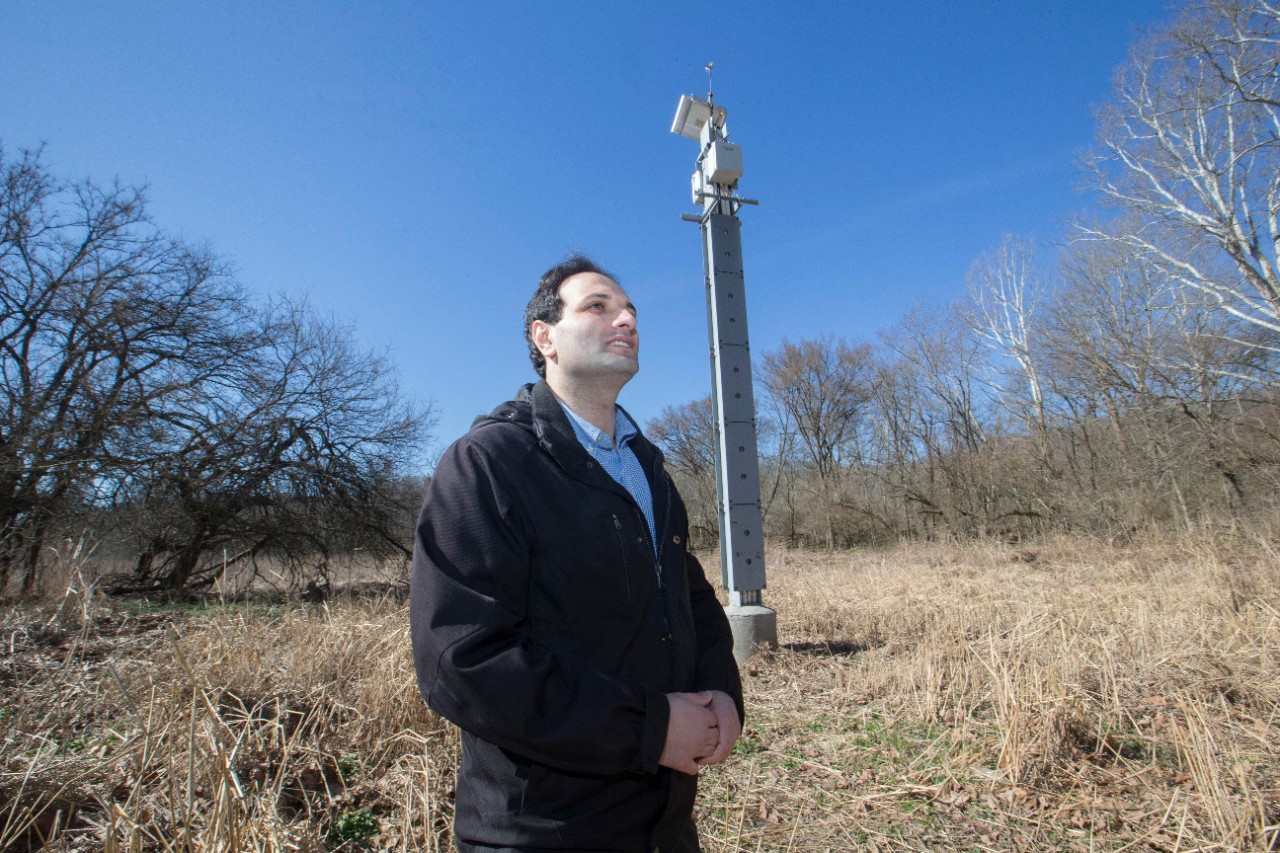 Reza Soltanian stands in front of a communications pylon at the observatory.