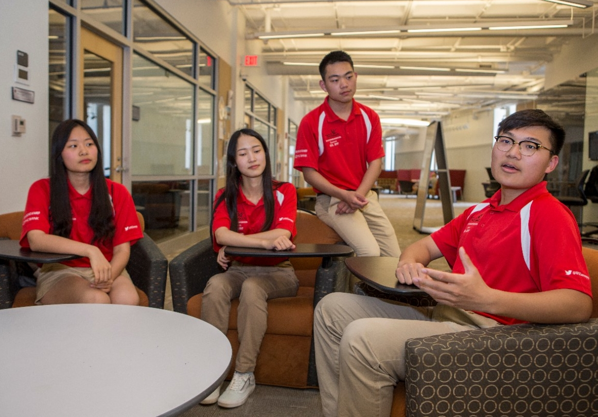 Four students sit in a study lounge at UC's Engineering Research Center.