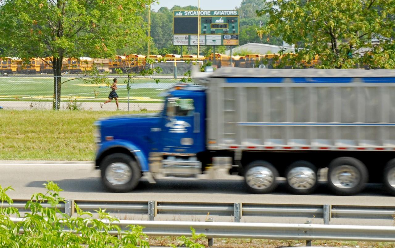 truck passing schoolbuses