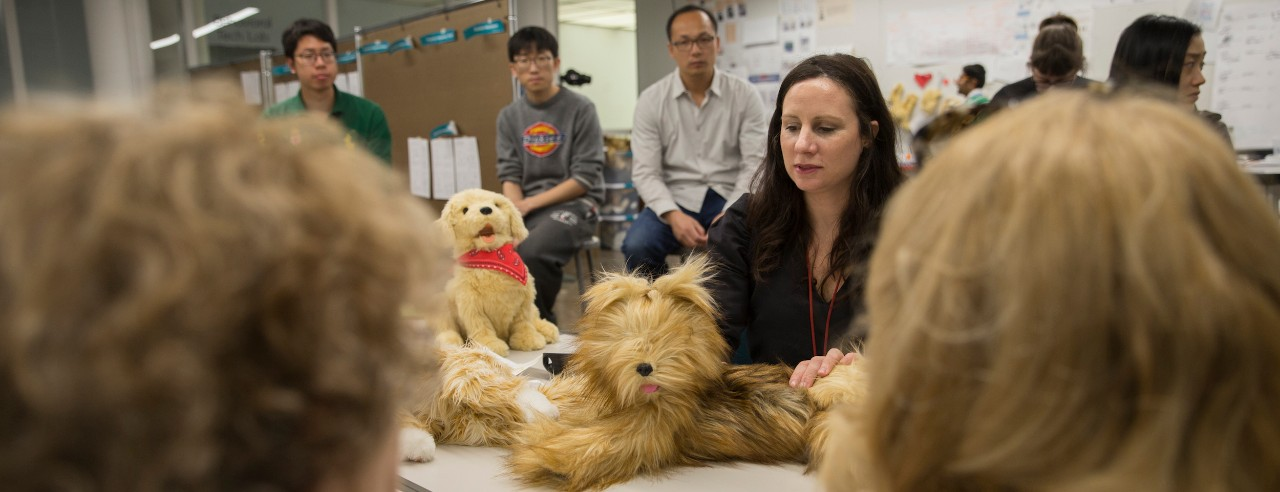 A class and professor showcase robotic dogs