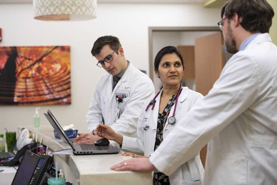 Medical student Domenic Termine is shown on clinical rotations with Anuja Gupta, MD