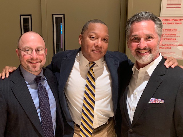 A candid photograph of Scott Belck, Wynton Marsalis and Stanley Romanstein.