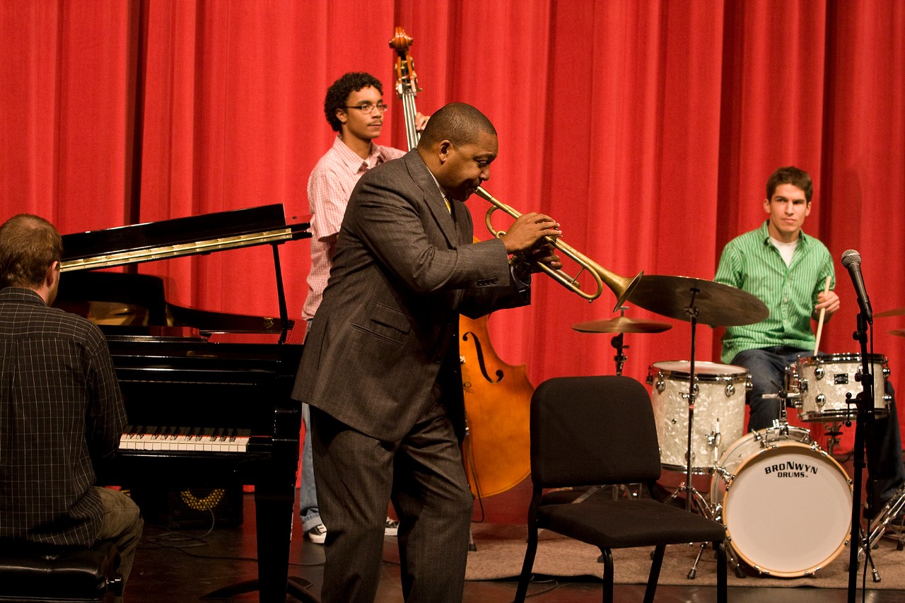 A photograph of Wynton Marsalis performing with CCM students during a visit to UC's campus in the fall of 2008.