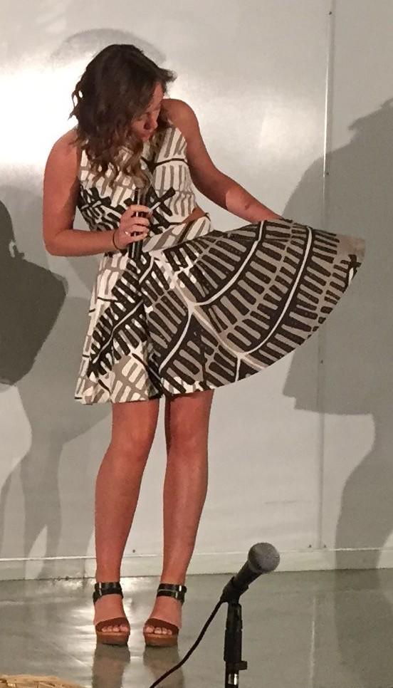 Natalie wears a dress she designed