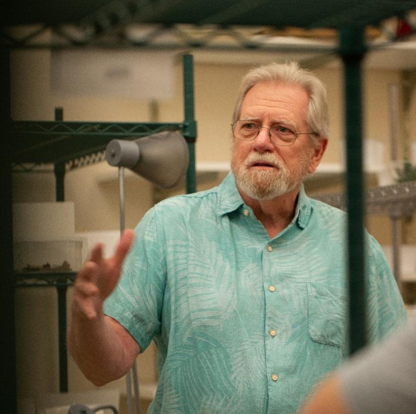 George Uetz framed by a lab shelf.