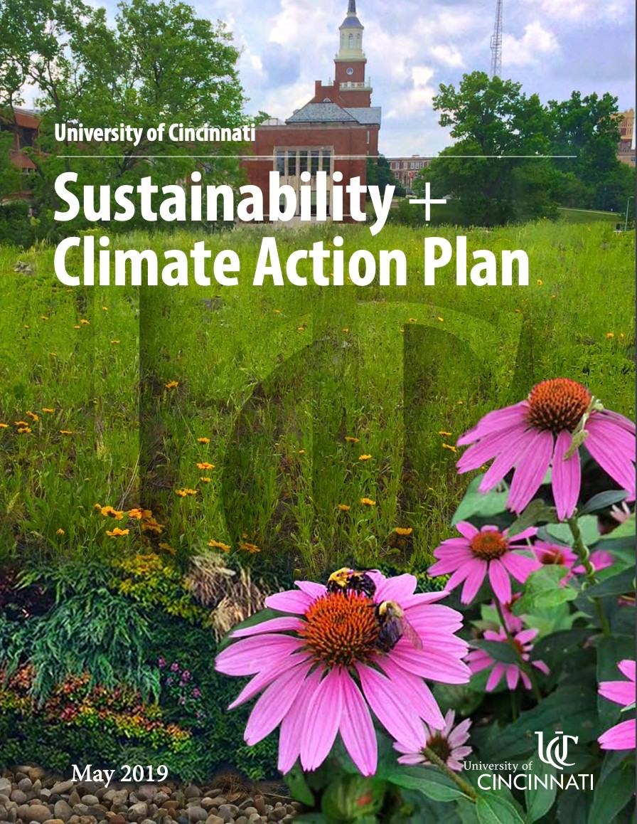 """Poster portrait of UC's McMicken Hall in background and daisy flowers in lower right corner. Over the photo are the words """"University of Cincinnati's Climate Action Plan"""" May 2019 and the UC logo superimposed over the foreground"""