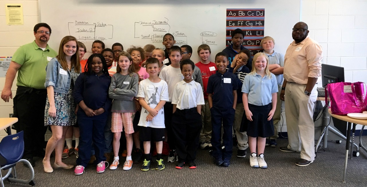 Amanda Bright stands with her after school chess students at Cincinnati's Chase Elementary School