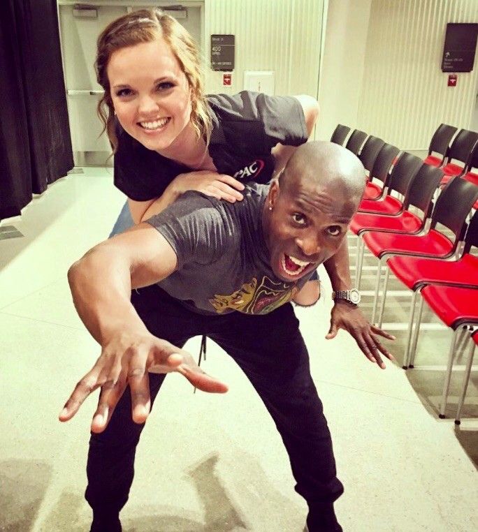 Amanda Bright sits on national comedian Godfrey's shoulders during a night of comedy on UC's campus.