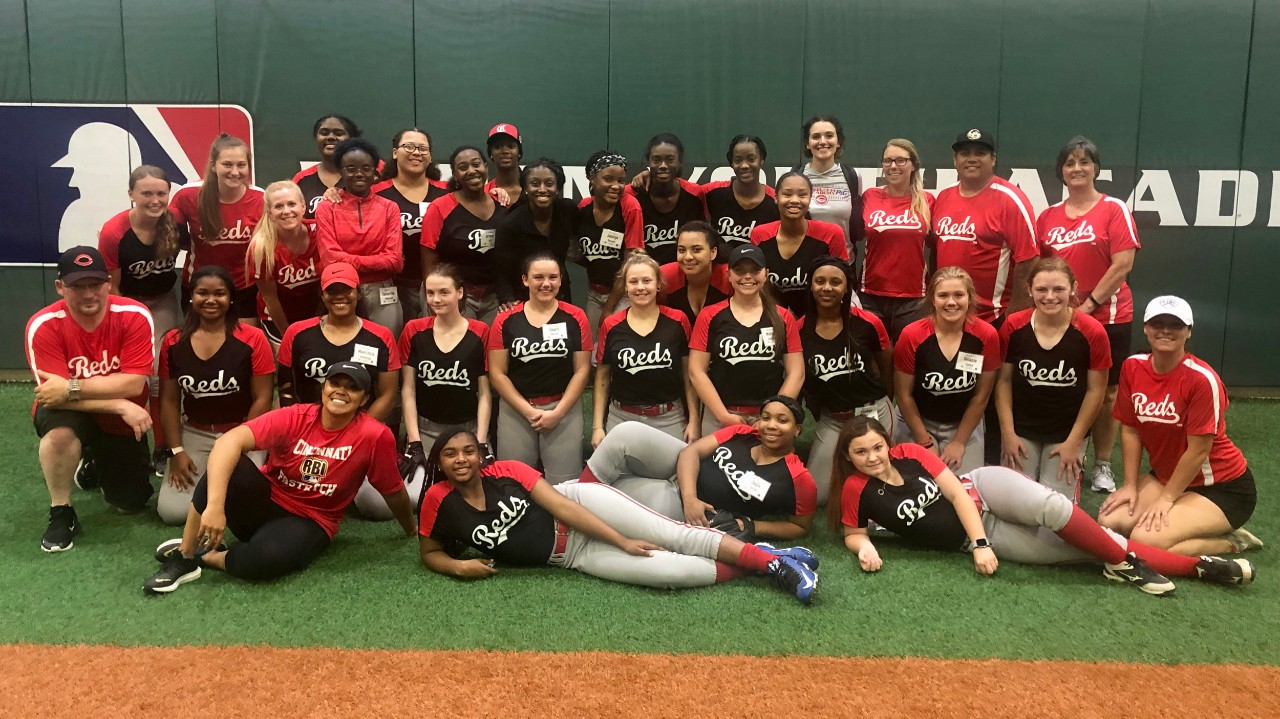 Girls softball players gather together during UC's 2019 Home Base camp.