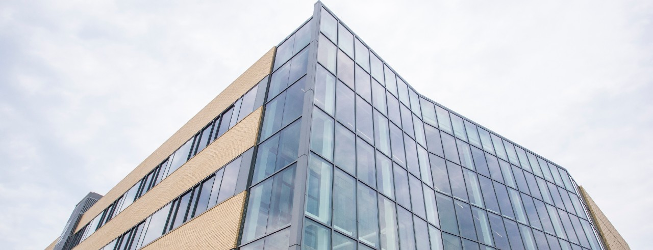 Exterior shot of a glass and brick building, the 1819 Innovation Hub