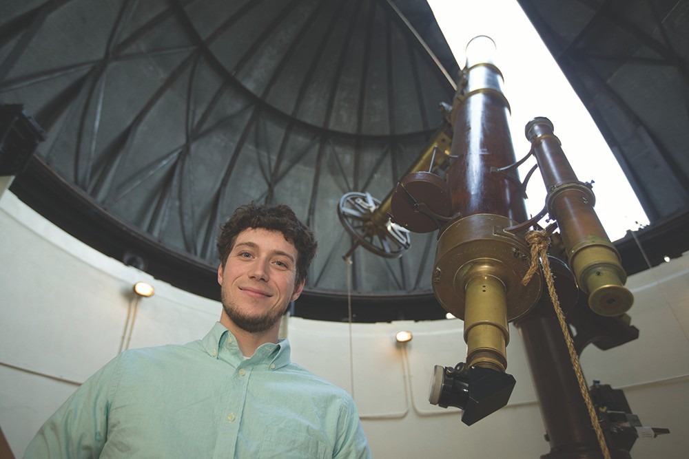 Kevin Wagner poses with a telescope.
