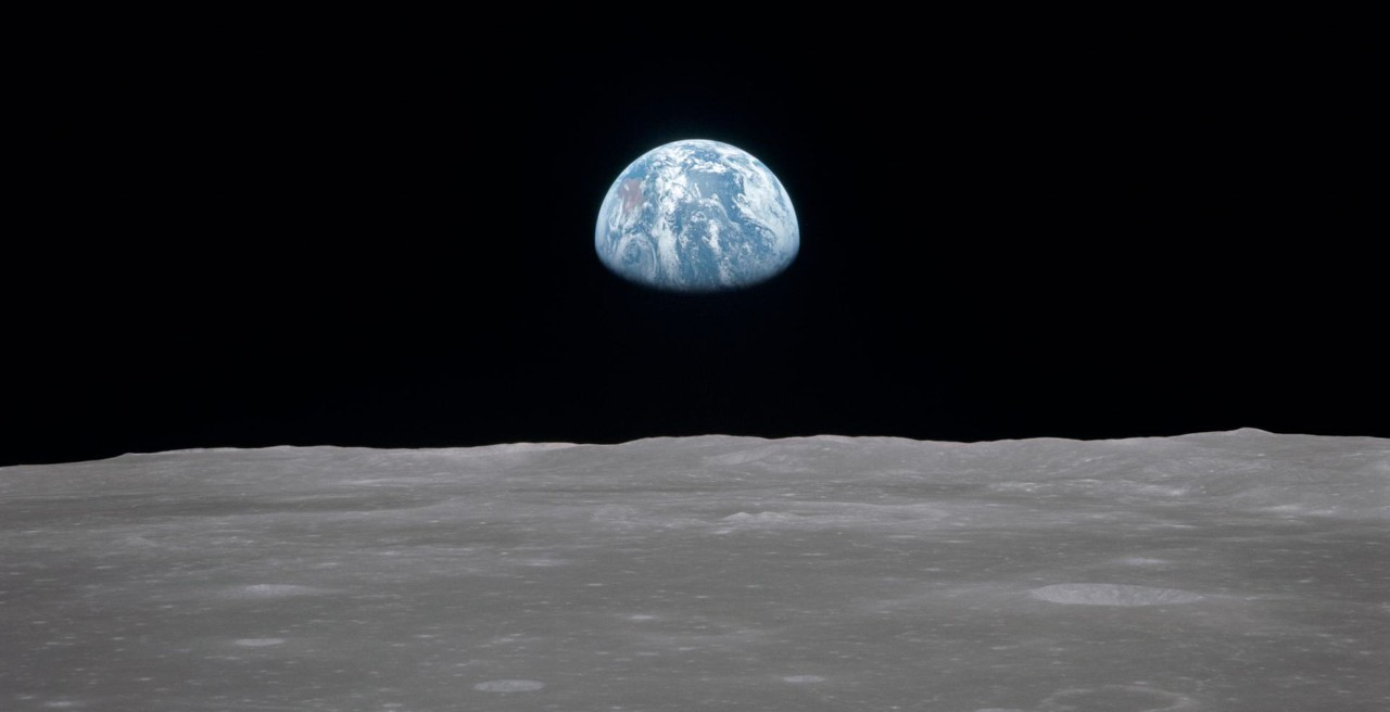 The Earth rises over the moon as viewed from the Apollo 11 spacecraft.