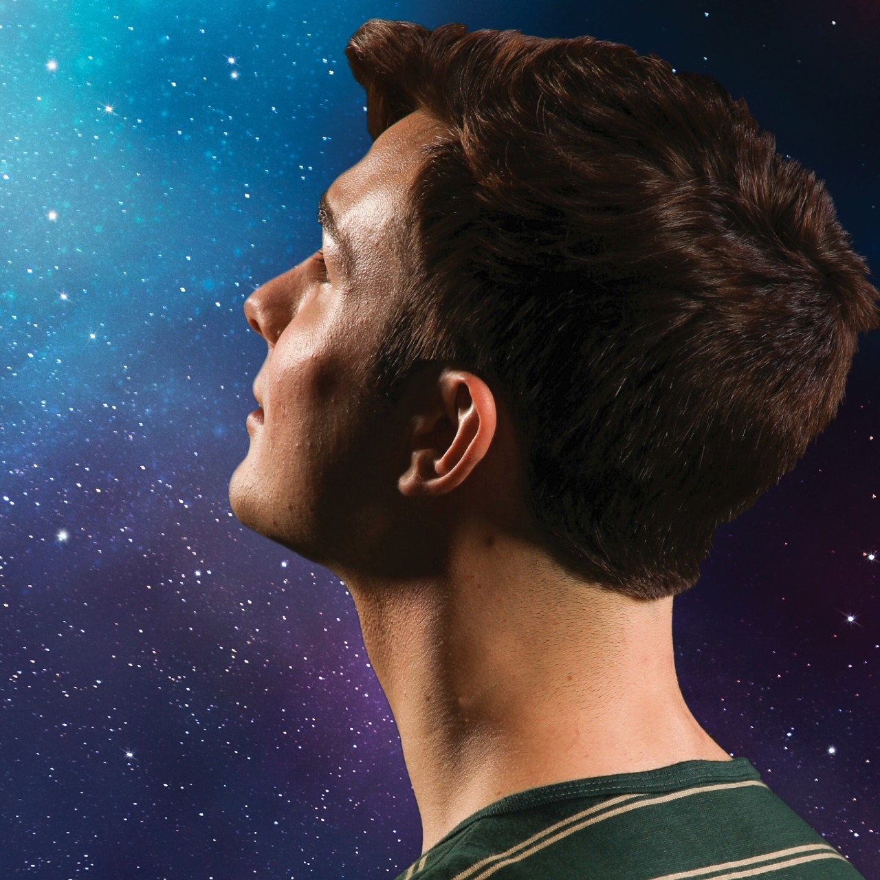 A young man stares into the night sky in a promotional image for the play 'The Curious Incident of the Dog in the Night-Time.' Photo by Mark Lyons.