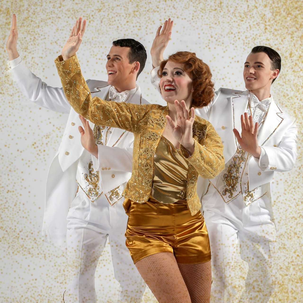 A woman and two men performing a musical number in a promotional image for the musical '42nd Street.' Photo by Mark Lyons.