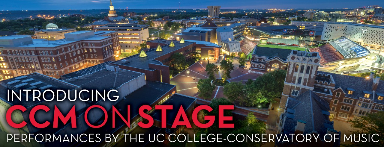 """A photograph of the CCM Village at night featuring the text: """"Introducing CCMONSTAGE: Performances by the UC College-Conservatory of Music."""" Photo by Jay Yocis/UC Creative Services."""
