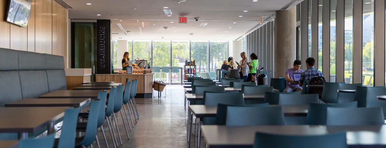 Interior shot of tables and booths at the new Starbucks