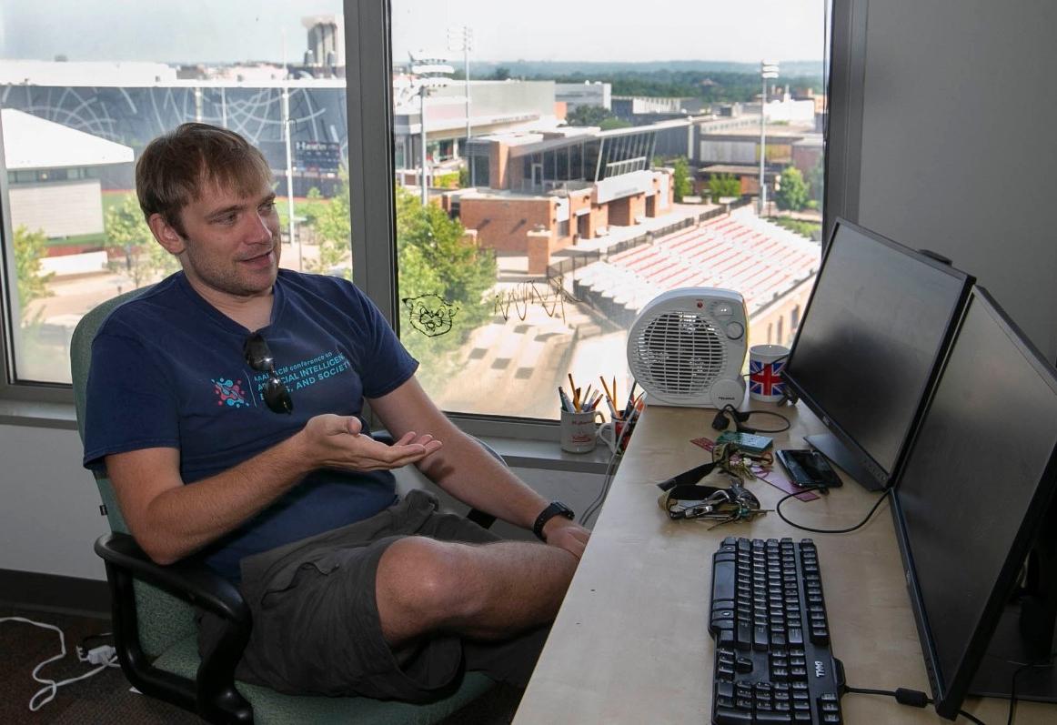 Dieter Vanderelst talks in his office overlooking the baseball field.