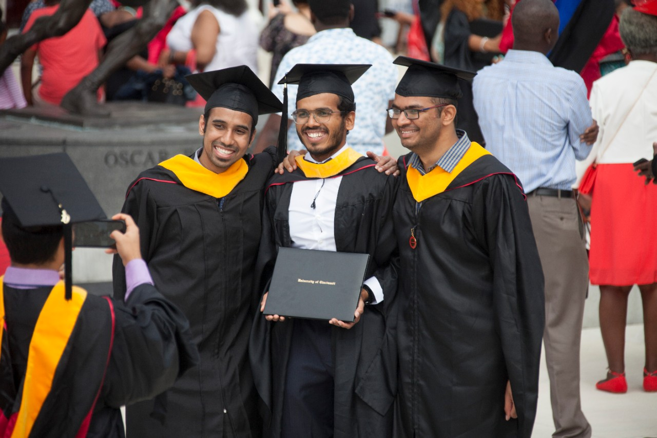 Students pose for photos.