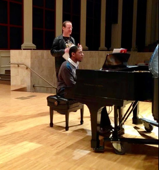 UC CCM's Brian Nabors plays piano on stage.