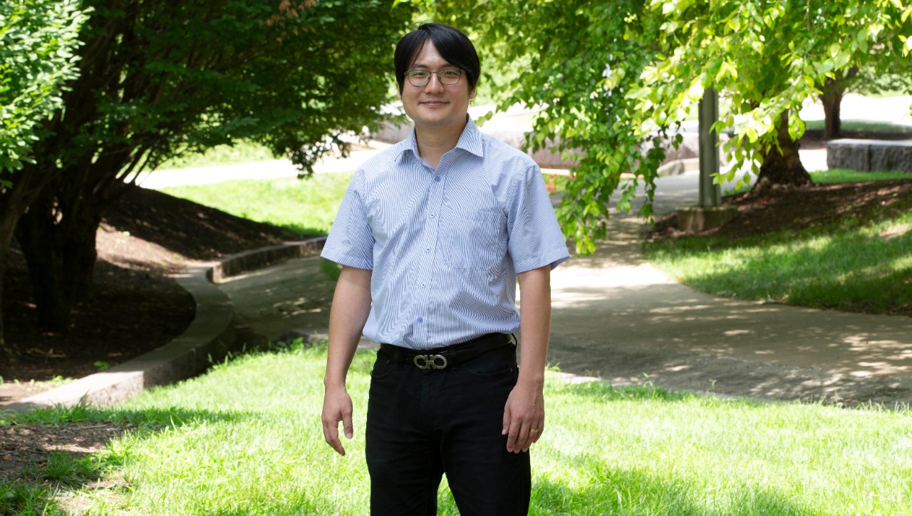Won Chang poses for a picture on UC's green campus.