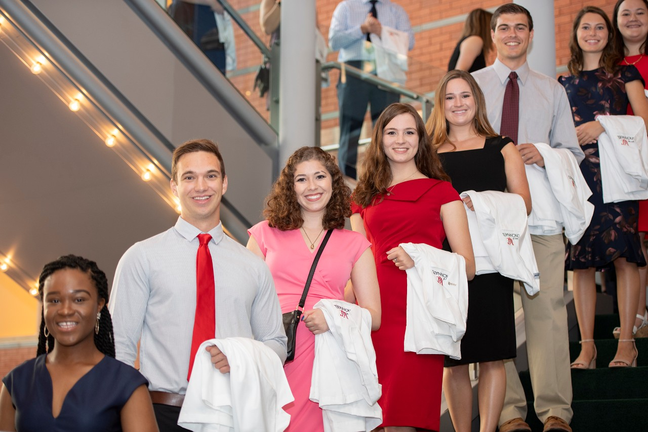 Medical students line up for the 2019 White Coat Ceremony at Aronoff Center.