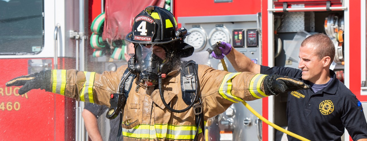 Firefighters demonstrate decontamination