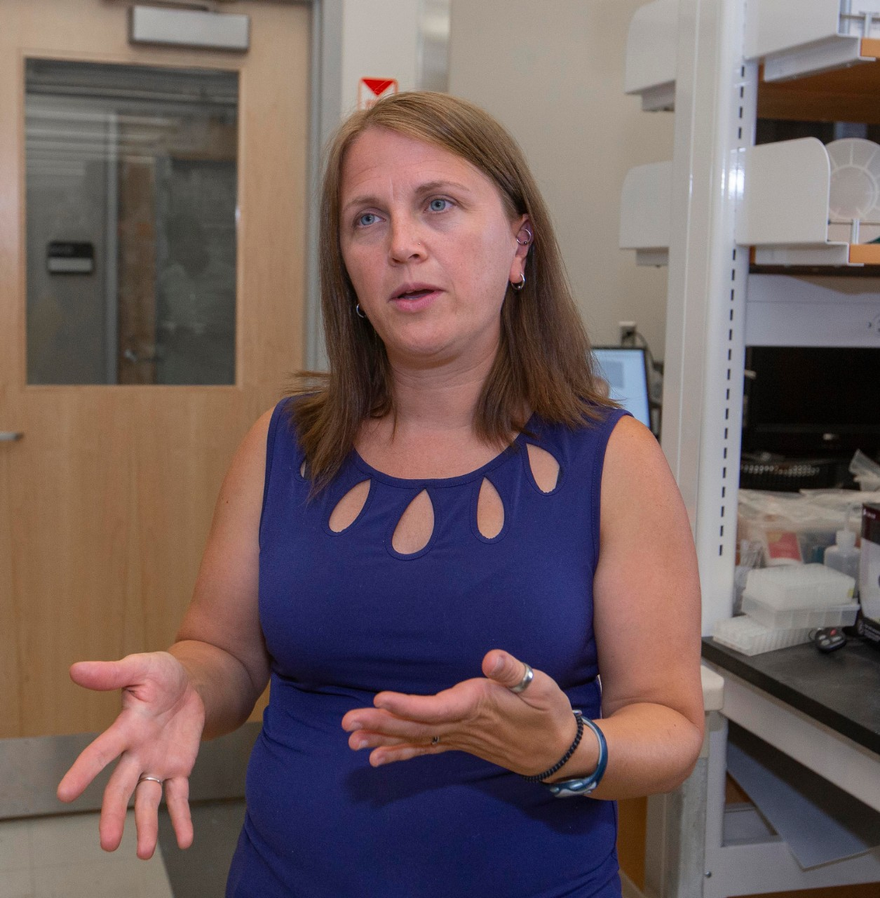 Lucinda Lawson gestures while talking in a biology lab.