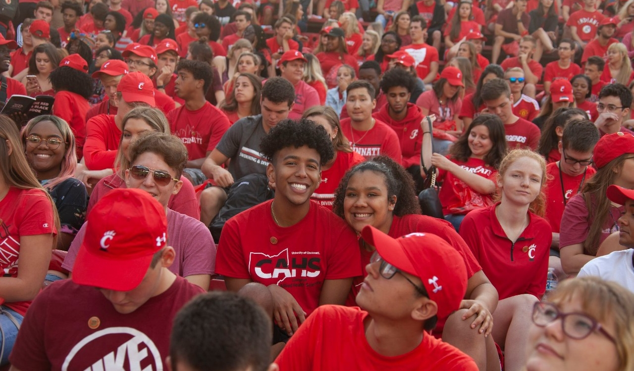 Large crowd of students dressed in red