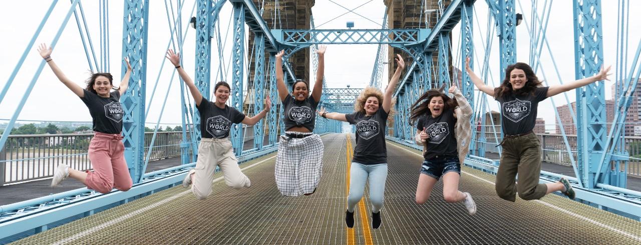 Young women jump on Cincinnati's Roebling Suspension Bridge