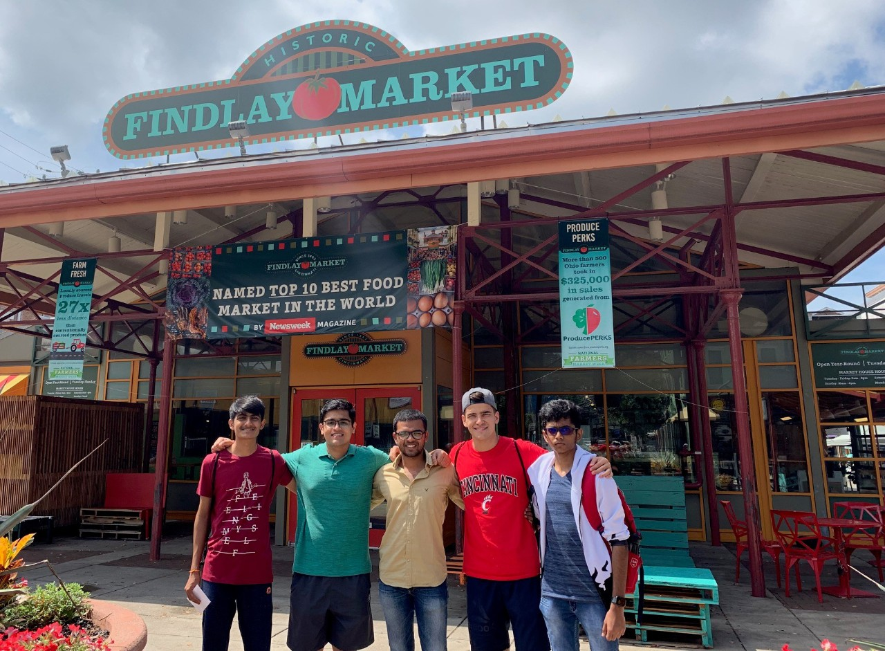 Students pose in front of Findlay Market