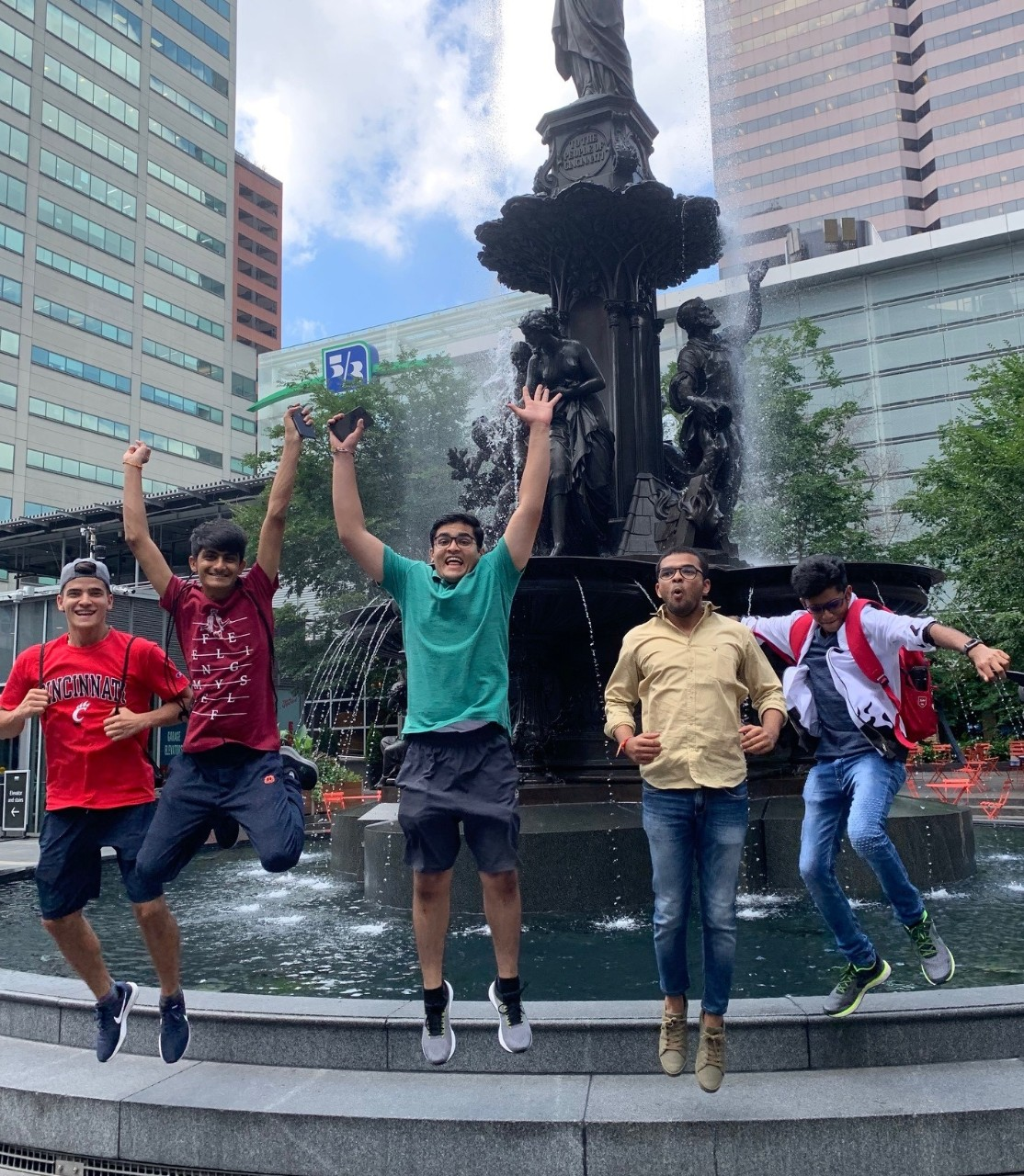 Students jump in front of the historic fountain