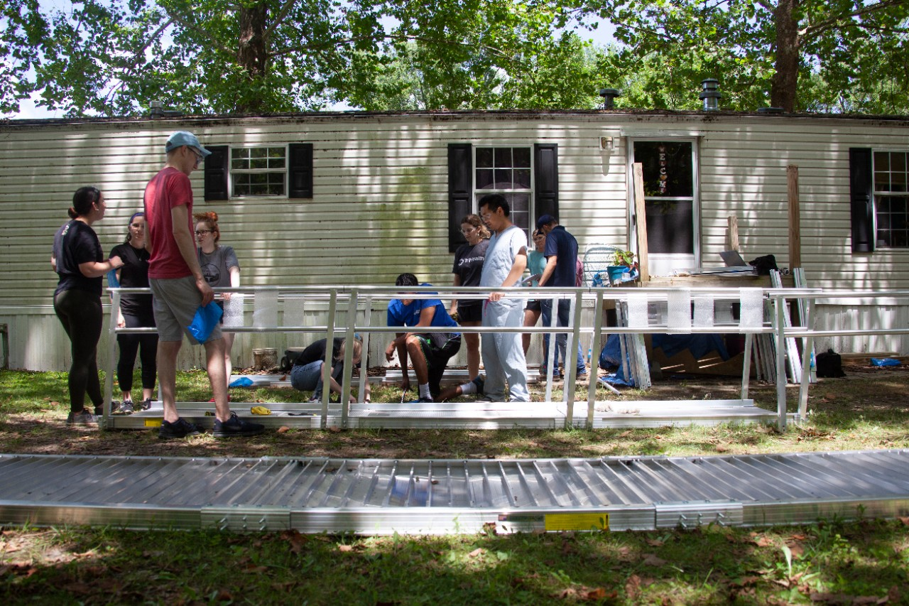 UC medical students build an accessibility ramp for a Northern Kentucky resident.