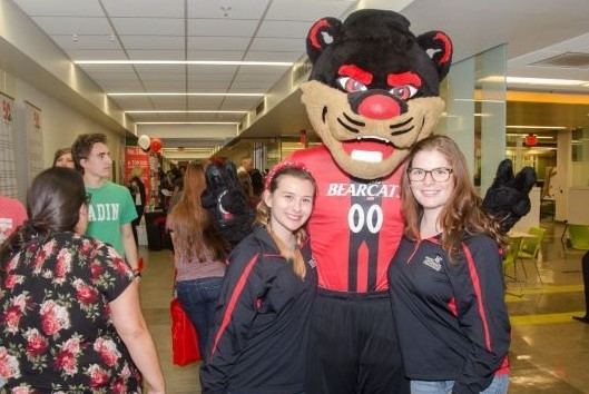 Bearcat mascot with UC Blue Ash College students at open house event