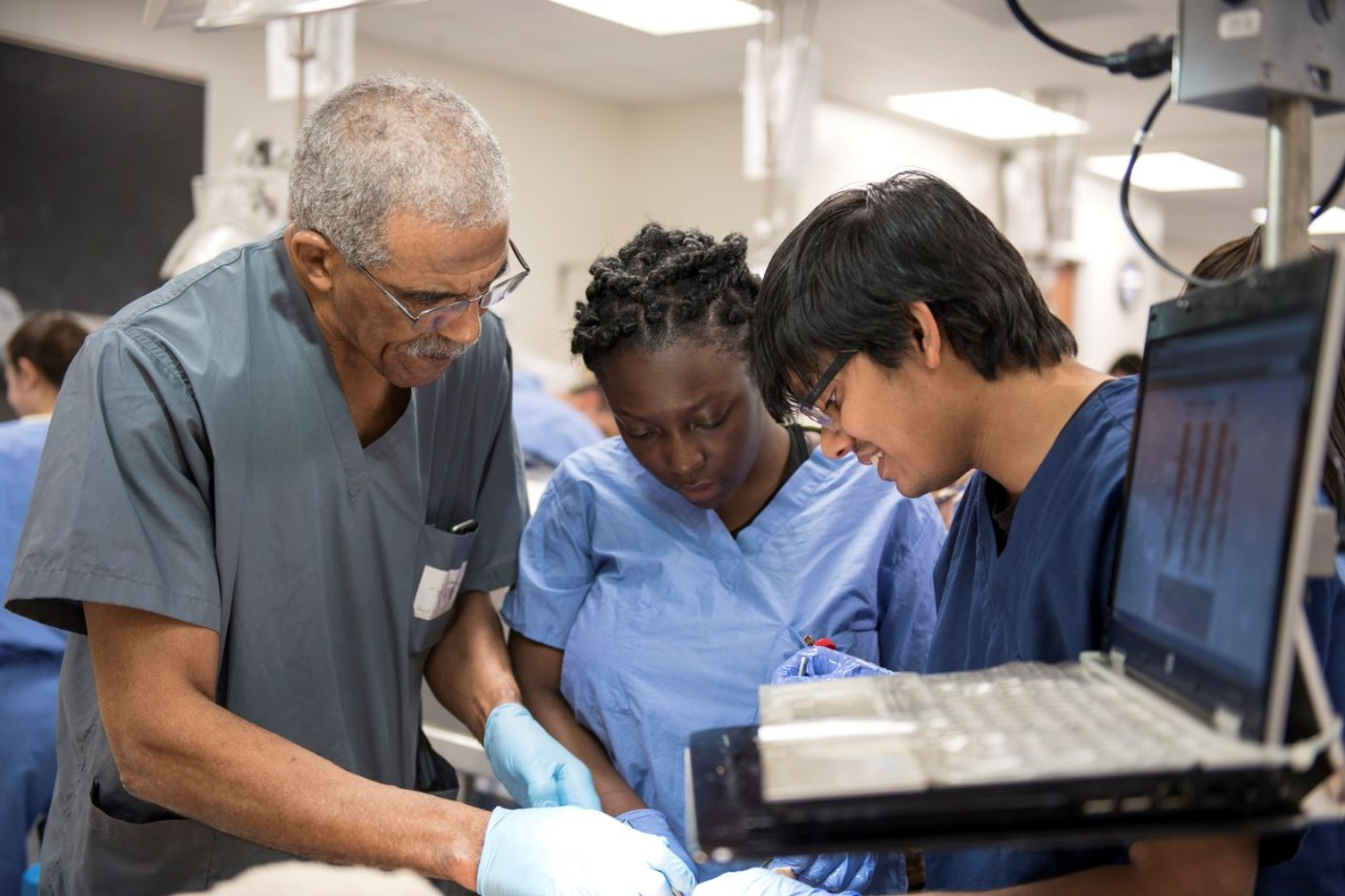 Alvin Crawford, MD, with students in the anatomy lab