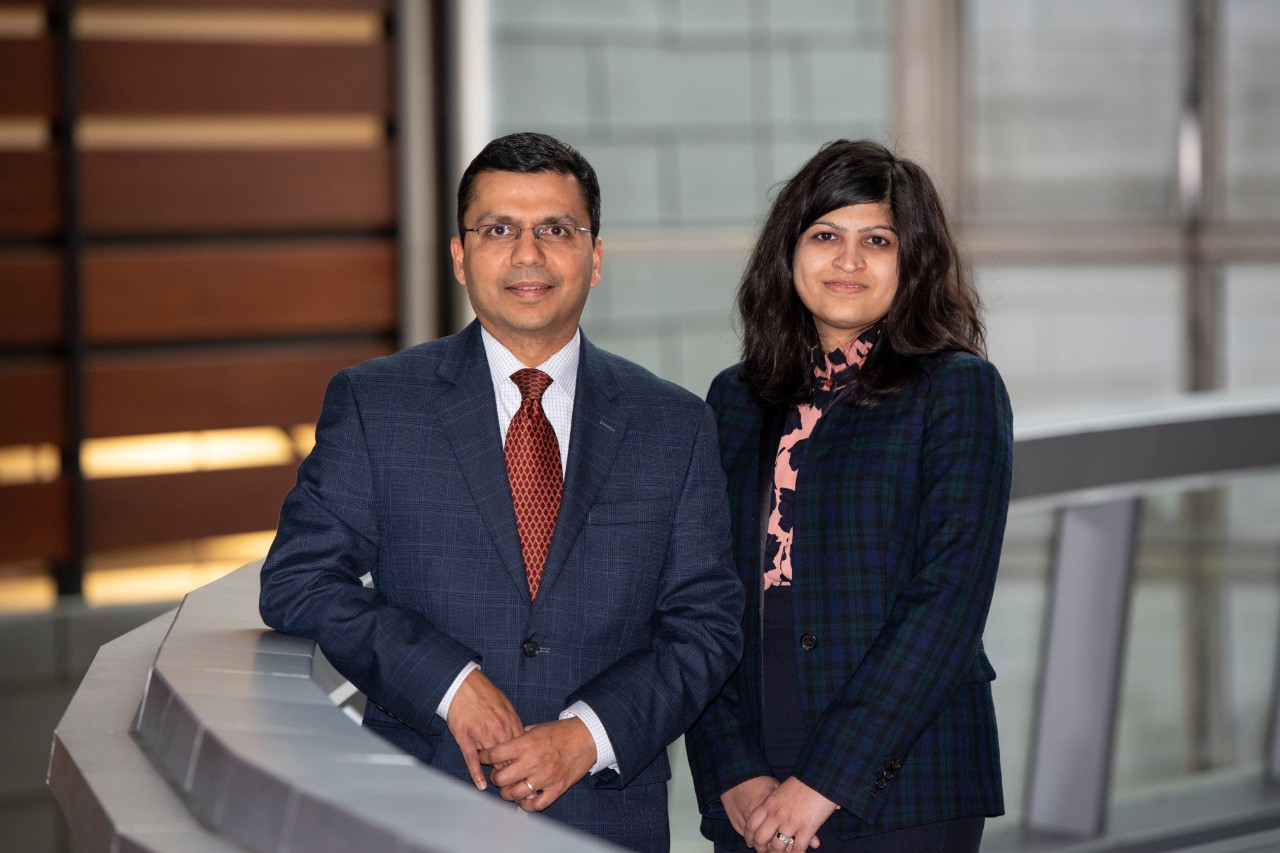 Dr. Charuhas Thakar and Dr. Silvi Shah on a bridge in the CARE/Crawley Building.