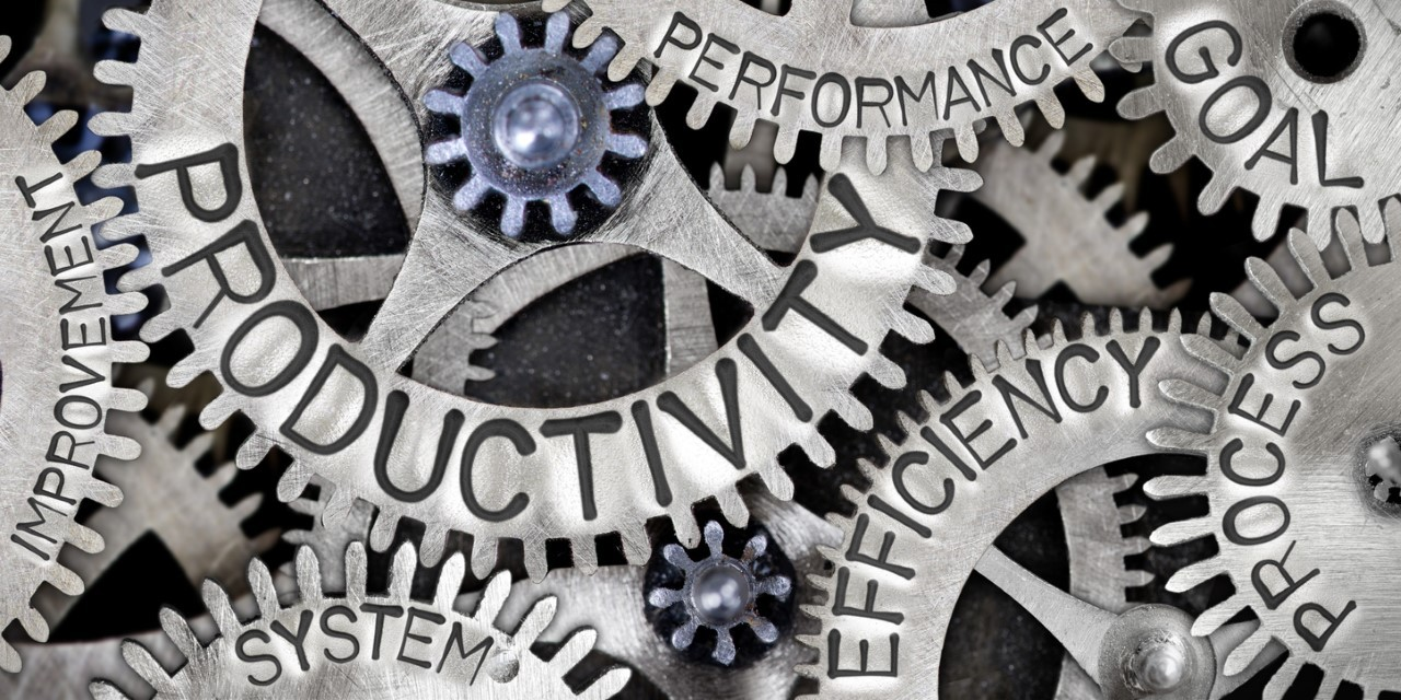 A graphic of machinery with the words productivity, efficiency, performance and goals on the cogs.