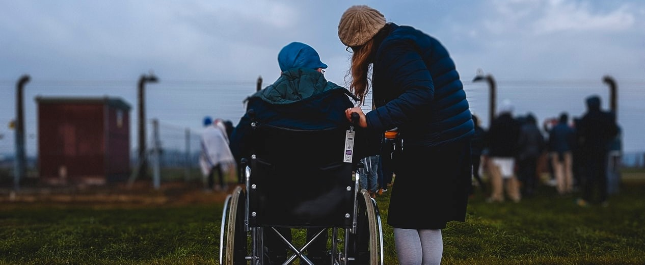 caregiver with patient in wheelchair