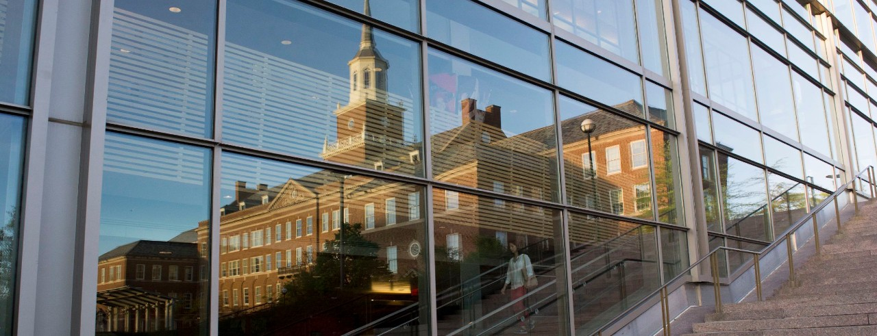 McMicken Hall in reflection of University Pavilion