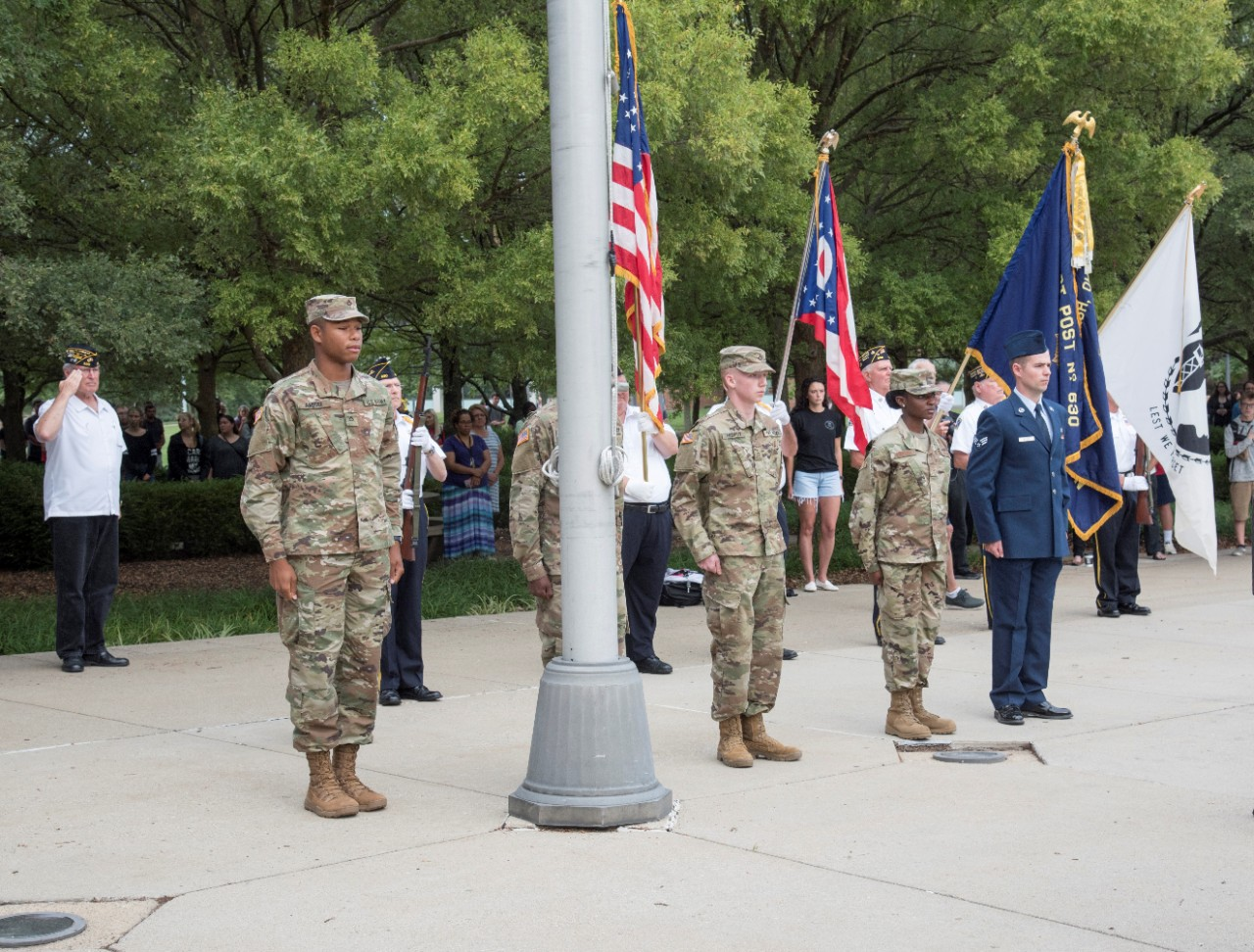 Veteran students stand at attention during the Sept. 11 ceremony on the UC Blue ASh Campus
