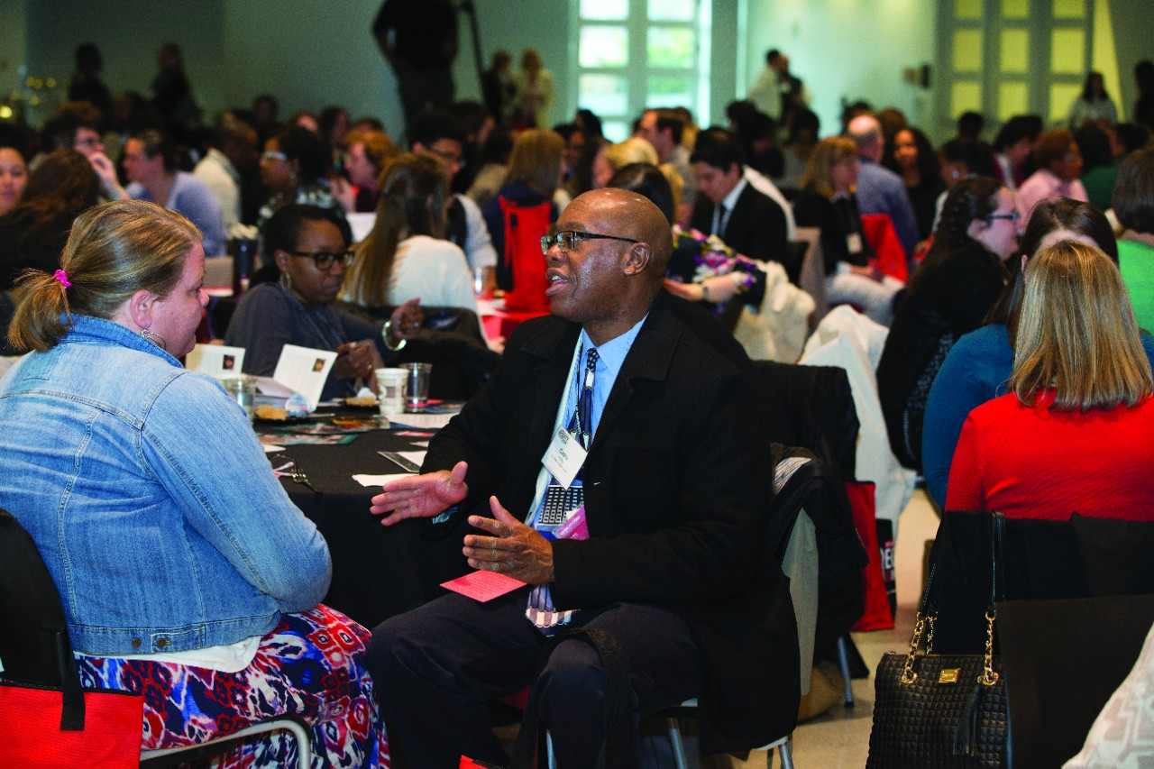 Participants at UC's Equity and Inclusion Conference interact during a session.