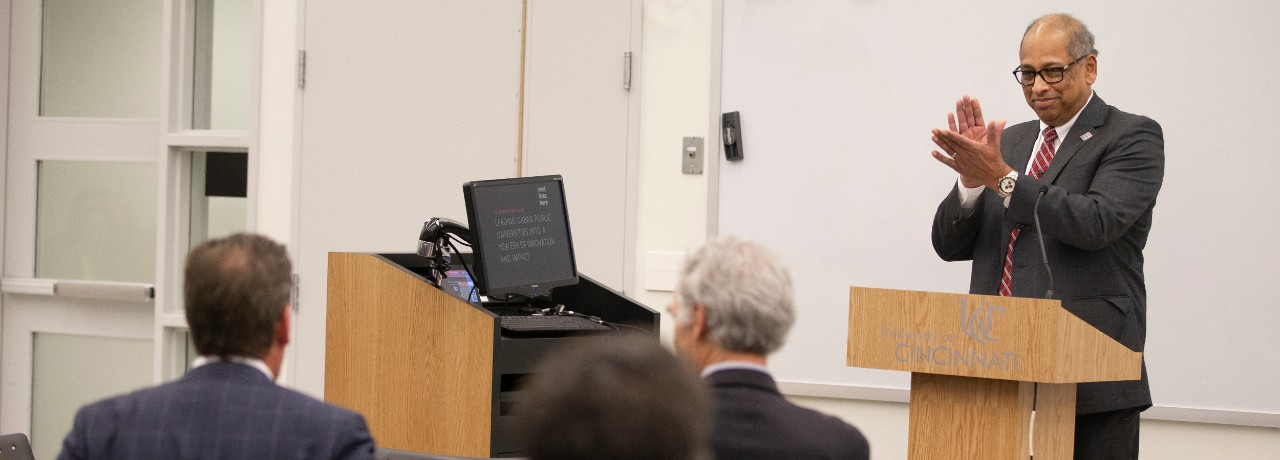 Image of President Neville Pinto applauding at the All-University Faculty Meeting on Oct. 31, 2019, in Room 400, TUC.