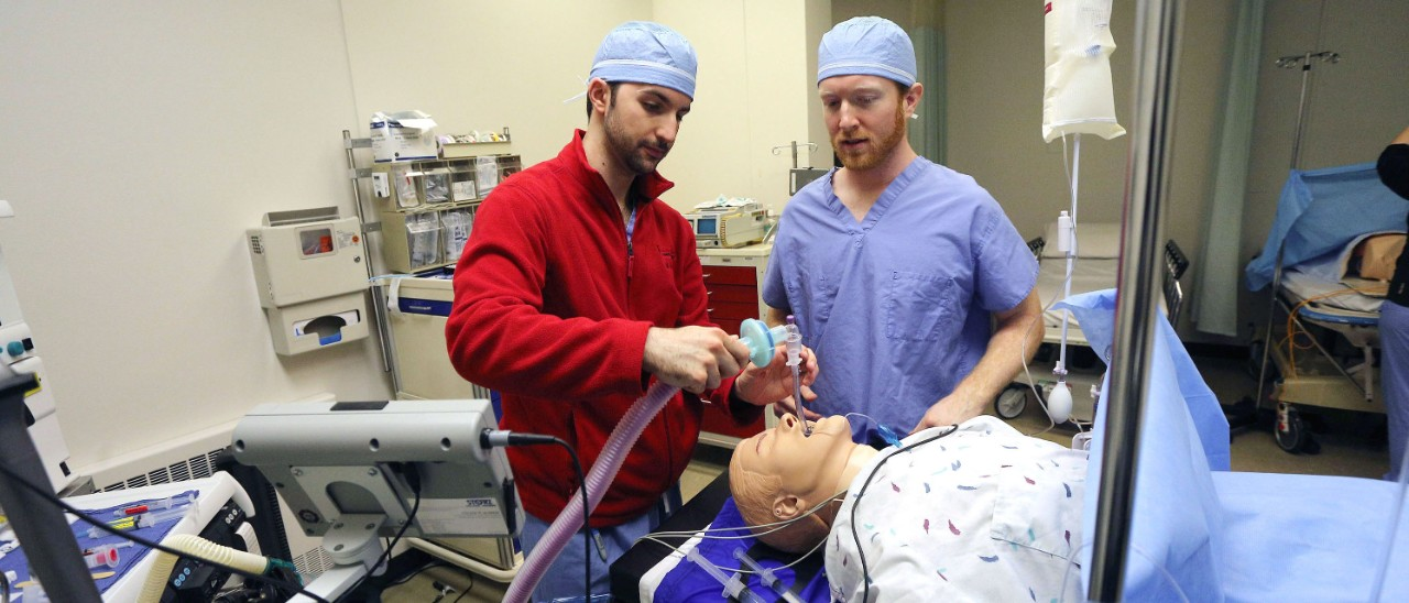 Two nursing students practice skills in the simulation laboratory.