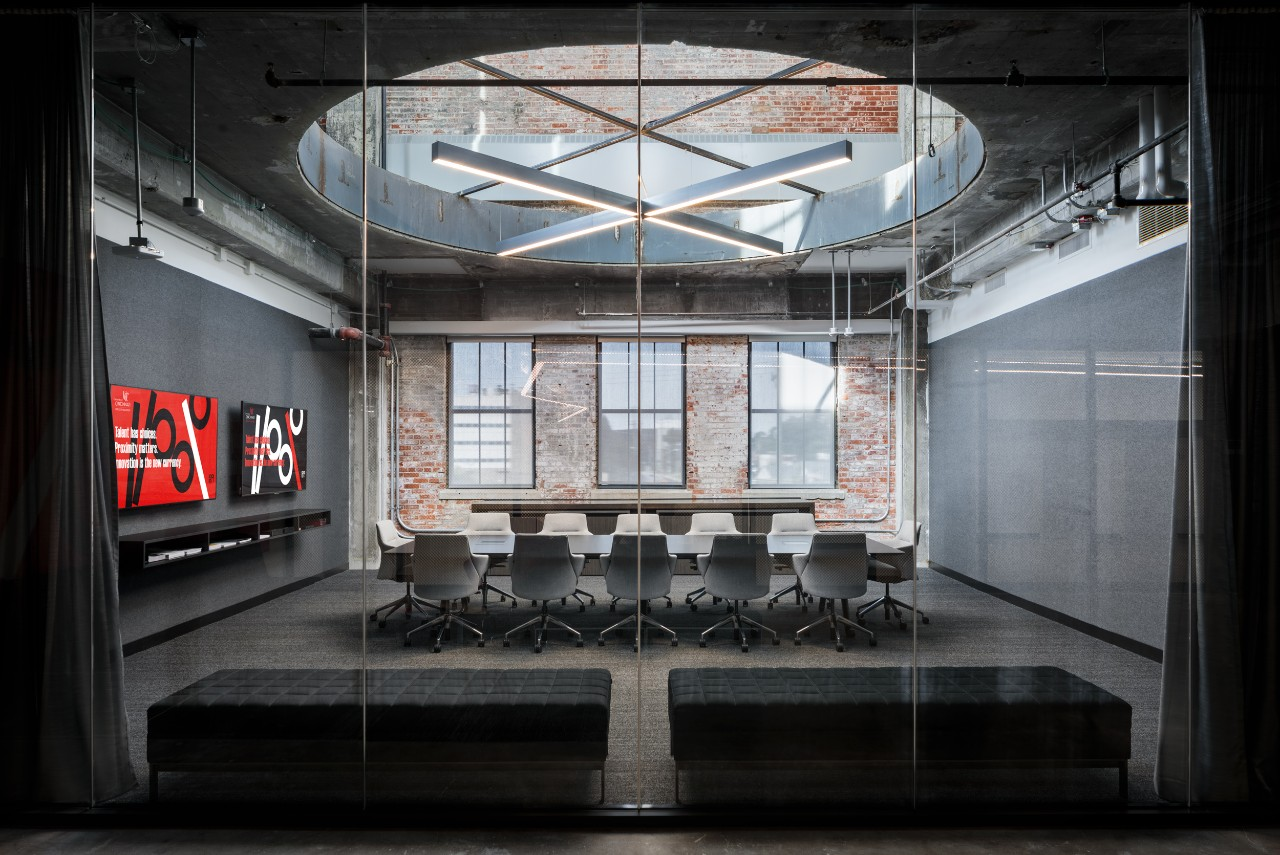 A conference room with a circular opening in the ceiling