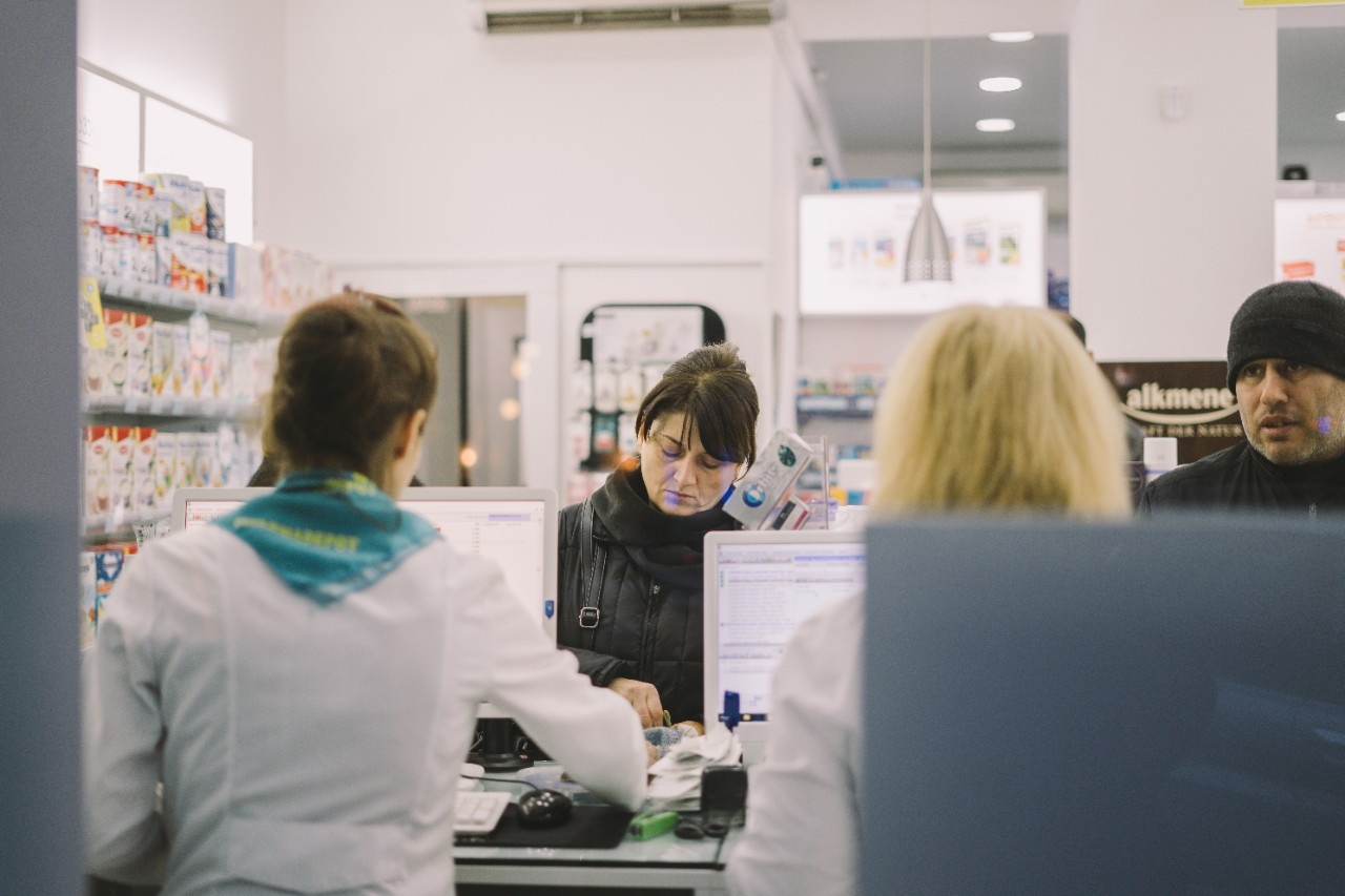 Customer in pharmacy getting prescription filled