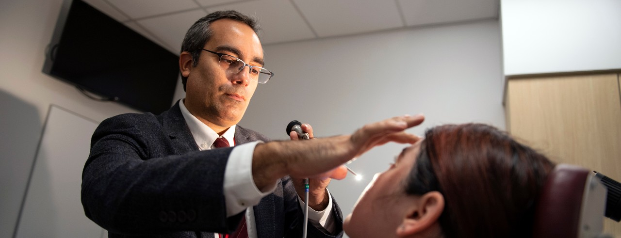 Ahmad Sedaghat, MD, PhD, shown examining a patient.