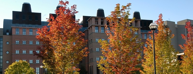 photo of engineer research center during the day with fall colored trees in the foreground