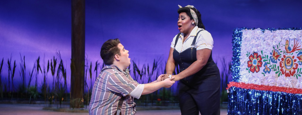 """Voice students sing to each other on stage during CCM's opera production of """"The Bartered Bride."""""""