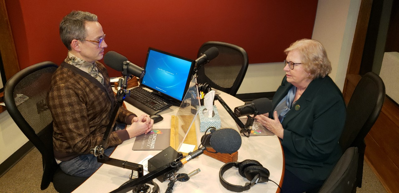 Susan Pinney, PhD, shown with radio broadcaster during interview.